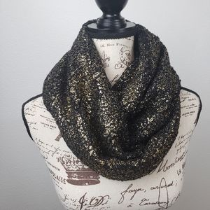 Express black and gold shimmery scarf.